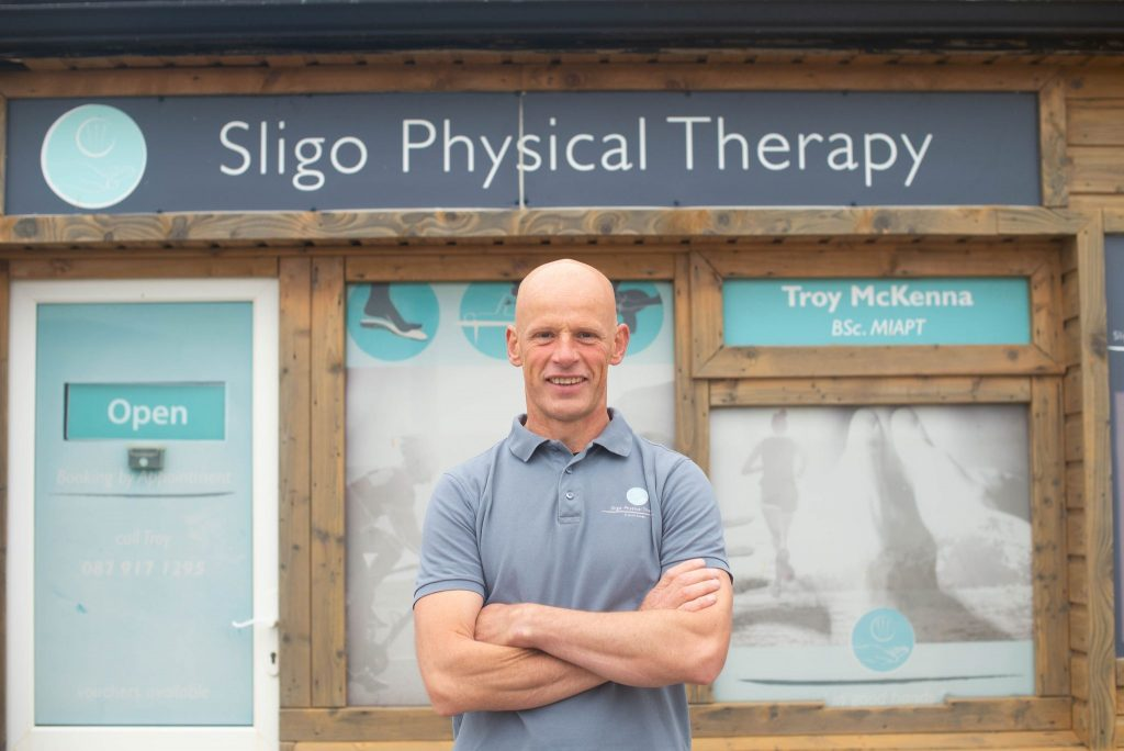 Physio/Physical Therapist Troy with arms folded outside his Strandhill based Physical Therapy/Physiotherapy practice